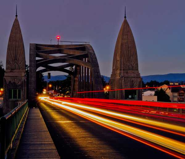 Slow shutter and fast traffic made this colorful picture on Siuslaw River bridge.